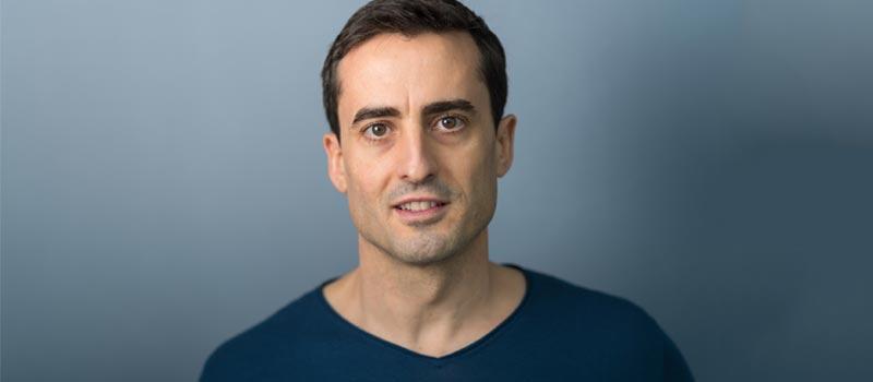 Porträt Dr. Daniel Holzinger, der Coaching in Stuttgart für Leistungs- und Spitzensportler durchführt