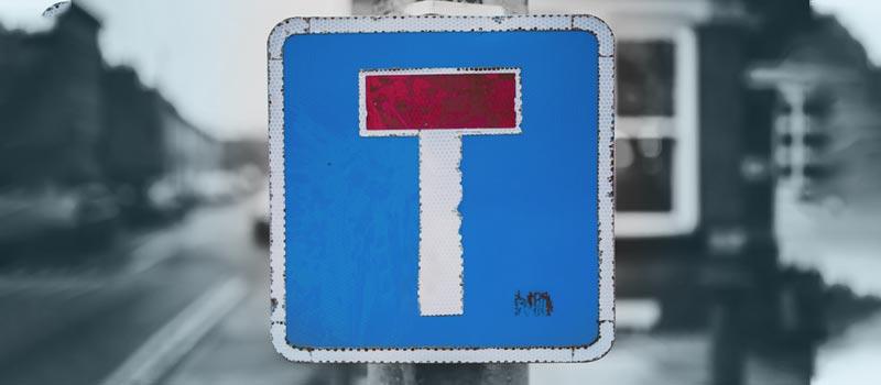 Sackgassen-Schild als Symbol für praktische Blockaden. Diese sind Teil der Effizienzblockaden.
